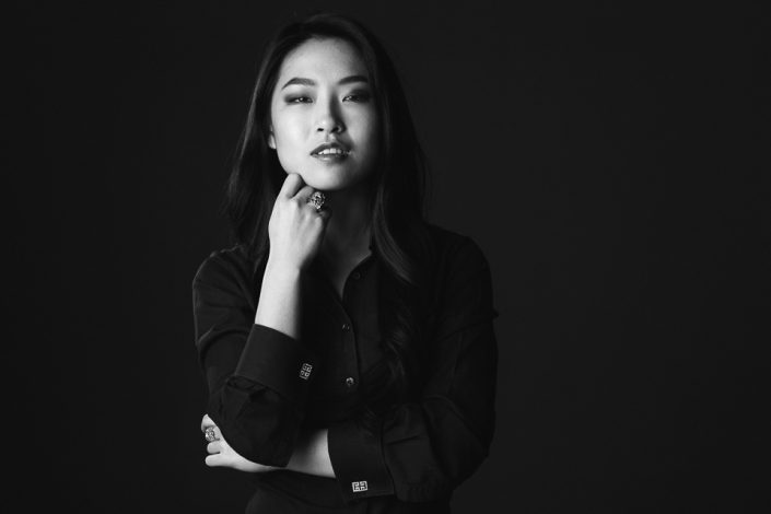 Business portrait woman on black background