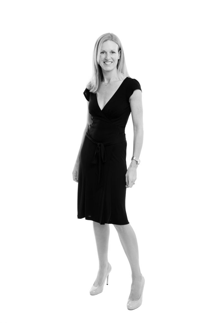 Black and white full length portrait, woman on white background
