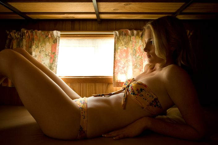 Girl reclining in caravan