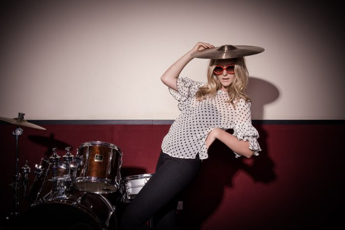 Girl with a cymbal on her head