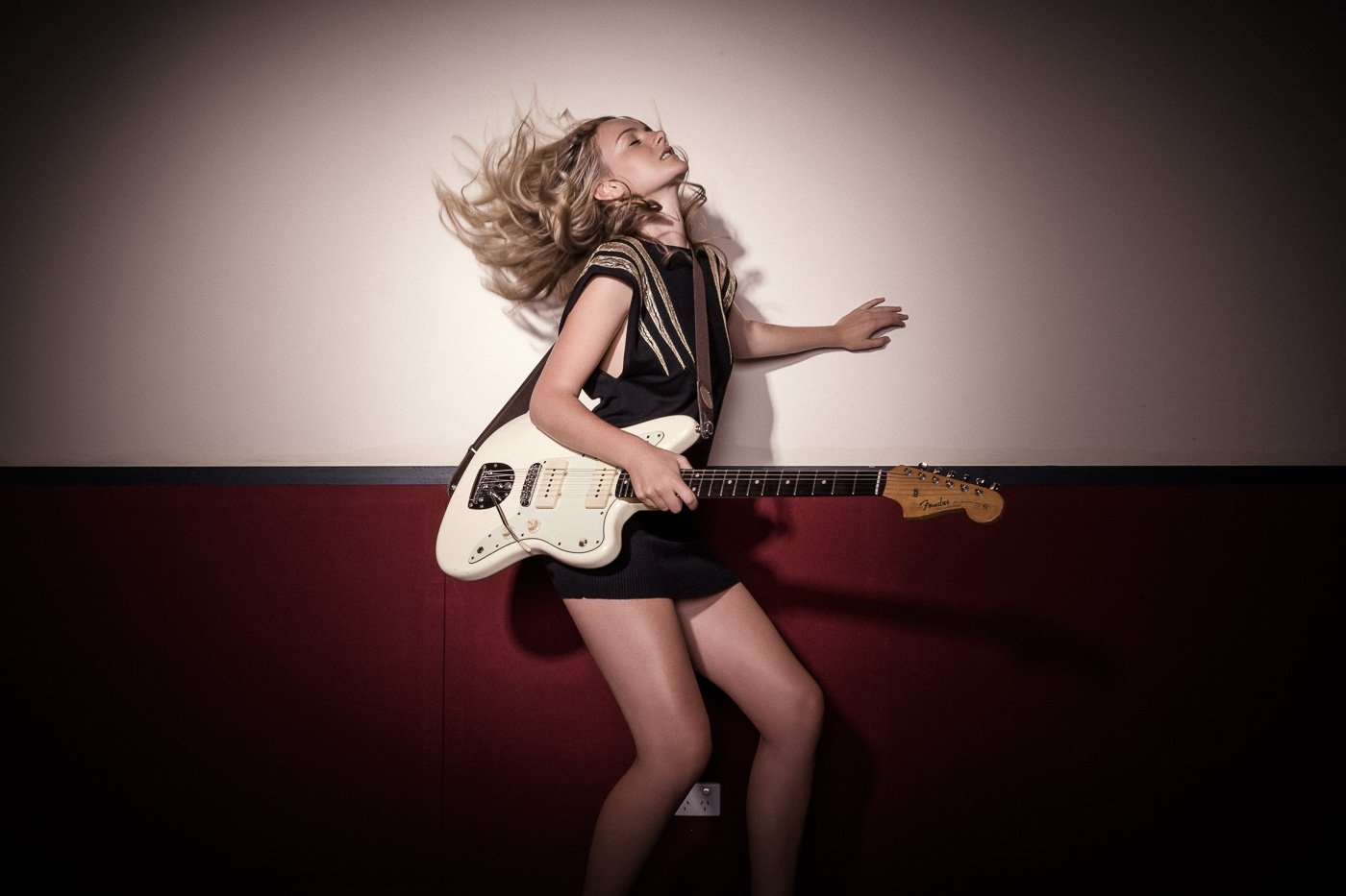 Girl rocking out with cream guitar