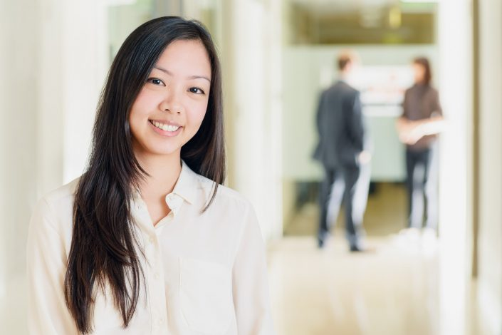 Woman posing in a corporate environment