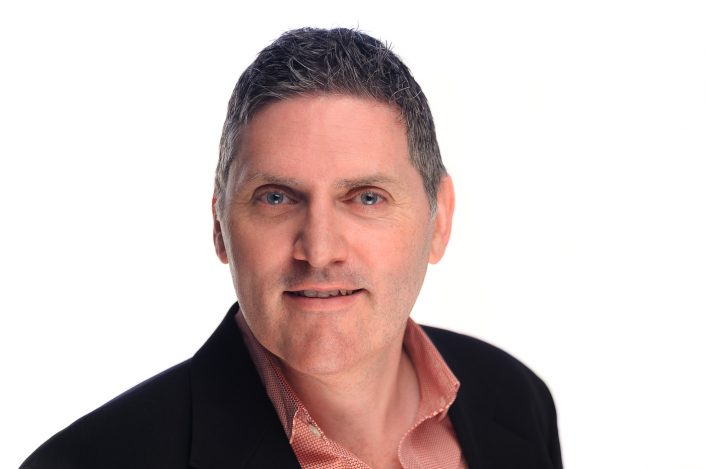 LinkedIn headshot, male on white background