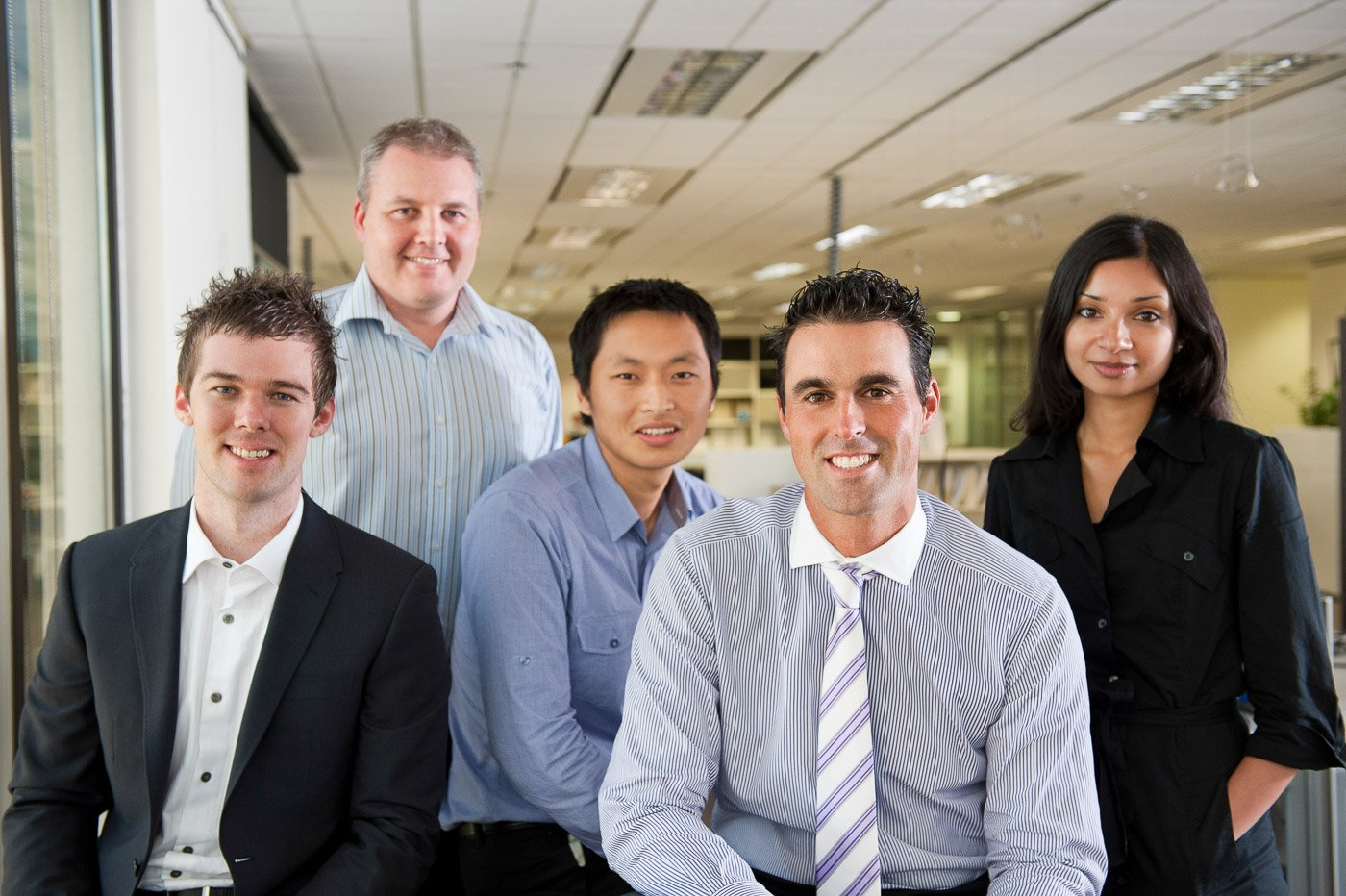 A team of people in a corporate office