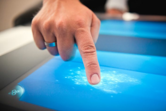 Close up of finger using a touchtable