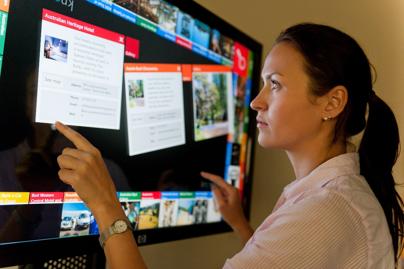 Woman interacting with a touchscreen