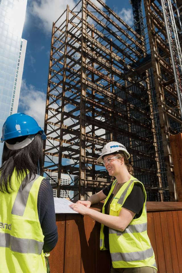 corporate photo of two women on a construction site