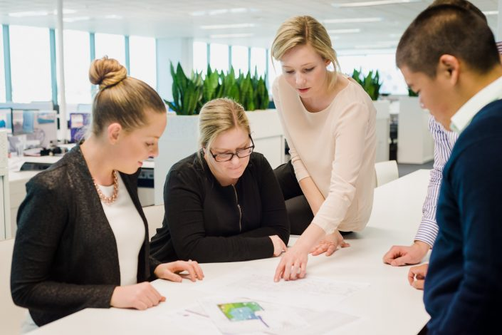 Photo of people working together in a modern office